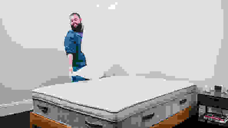 man putting sheets on awara mattress