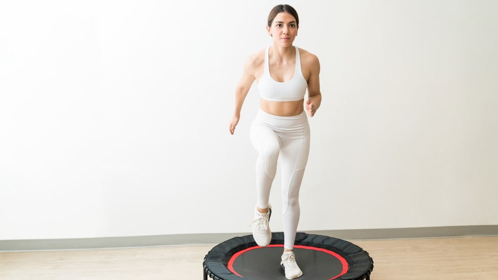 A woman jumping on a rebounder.