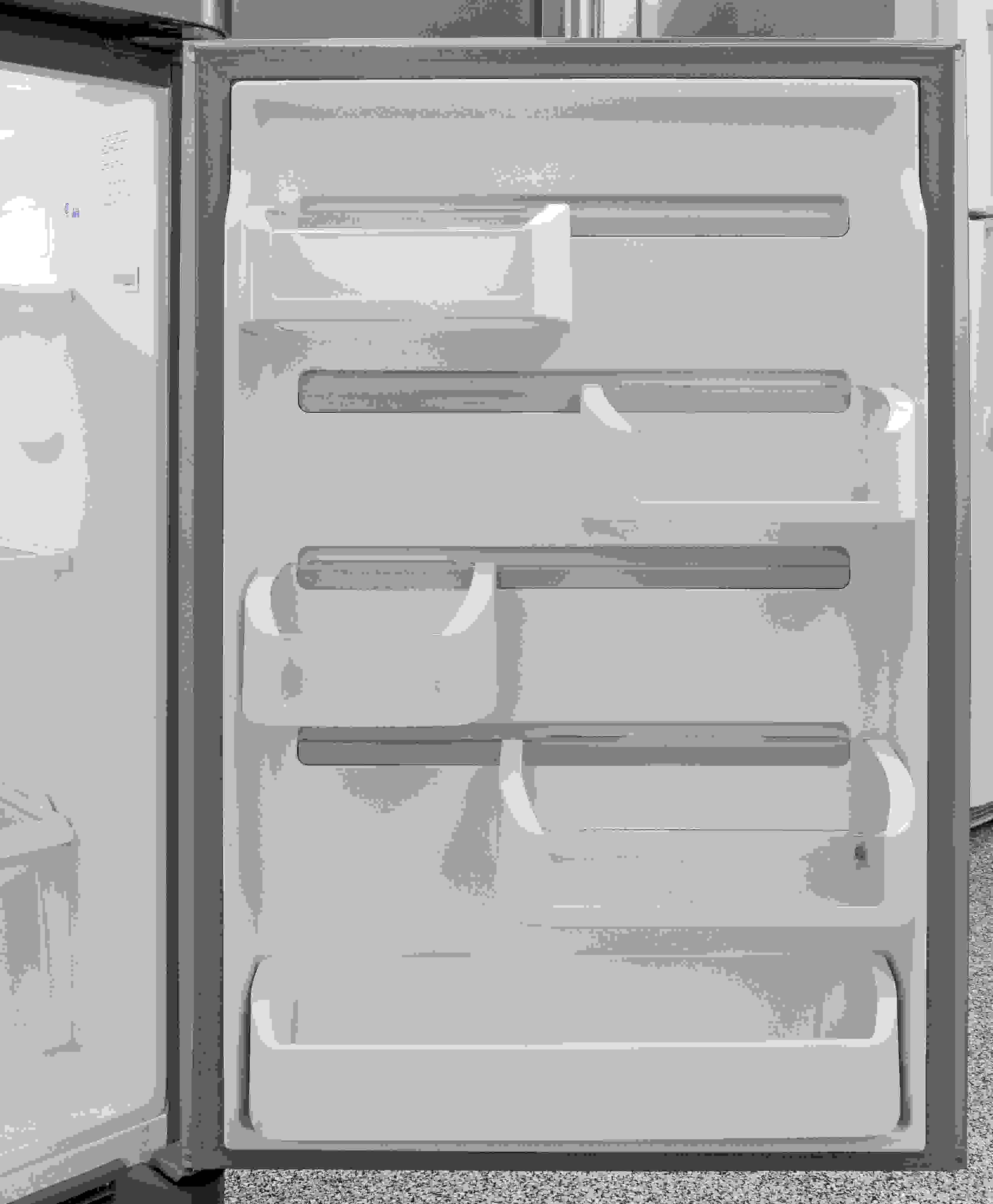 Sliding bucket shelves provide flexible door storage in the Frigidaire Gallery FGTR1845QF.