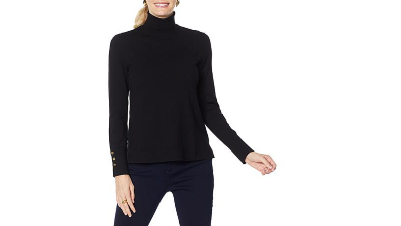 An image of a black turtleneck with gold button details on the sleeves.