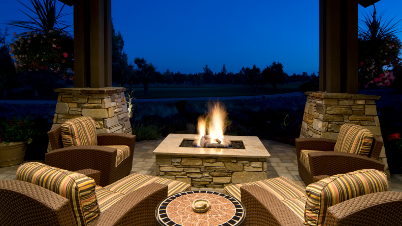 Patio next to a fire pit at dusk