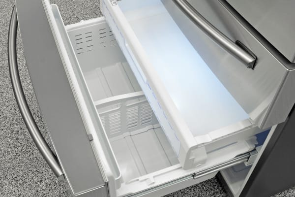 The Samsung RF28HMEDBSR's straightforward pullout freezer is roomy and well lit.