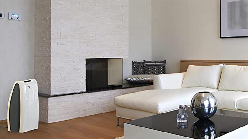 A Vornado air purifier sits in a modern living room.