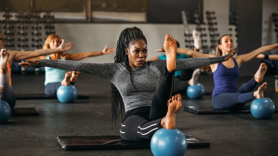 woman exercising in a pilates class