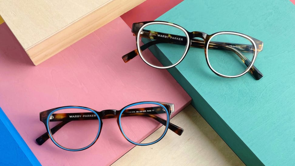 Two pairs of glasses on colorful blocks