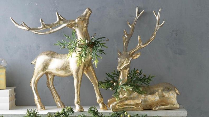 These sweet animals have holiday wreaths around their necks.