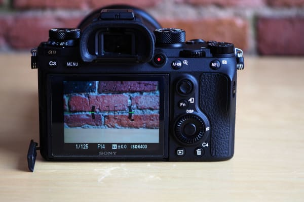 The rear controls on the A9 are thoughtfully laid out, though cramped compared to larger DSLRs from Canon and Nikon.
