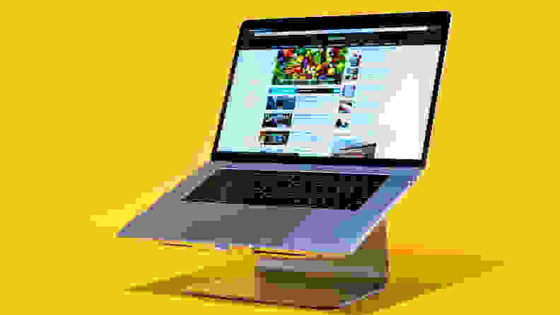 Laptop on stand with yellow background