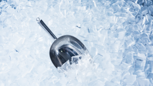 Close up photo of ice with scooper.