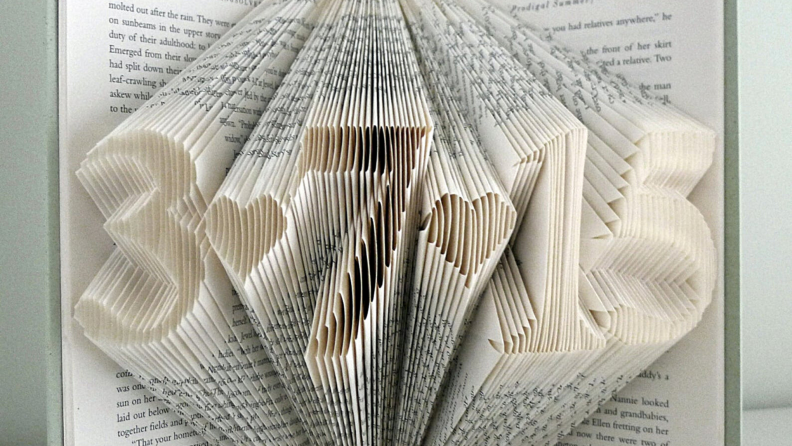 A personalized piece of book art with a date.
