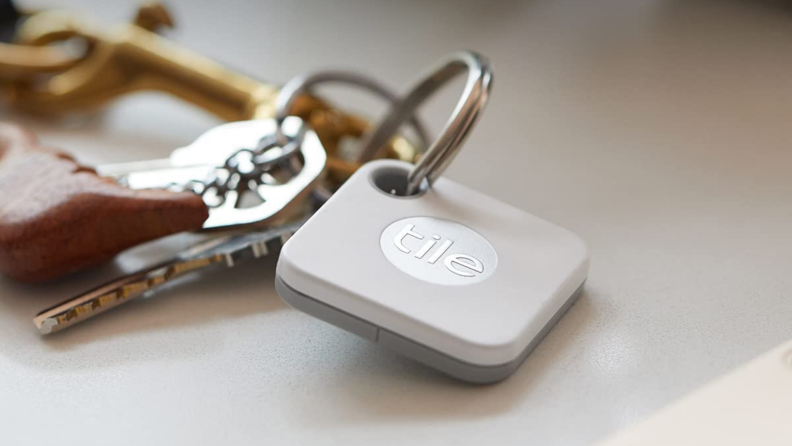 A Tile device attached to a keychain.