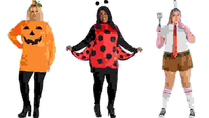 three women standing next to each other wearing costumes: pumpkin costume, ladybug costume, spongebob costume
