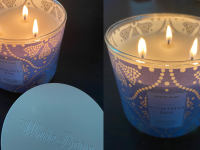 Bath & Body Works candle sitting on table.