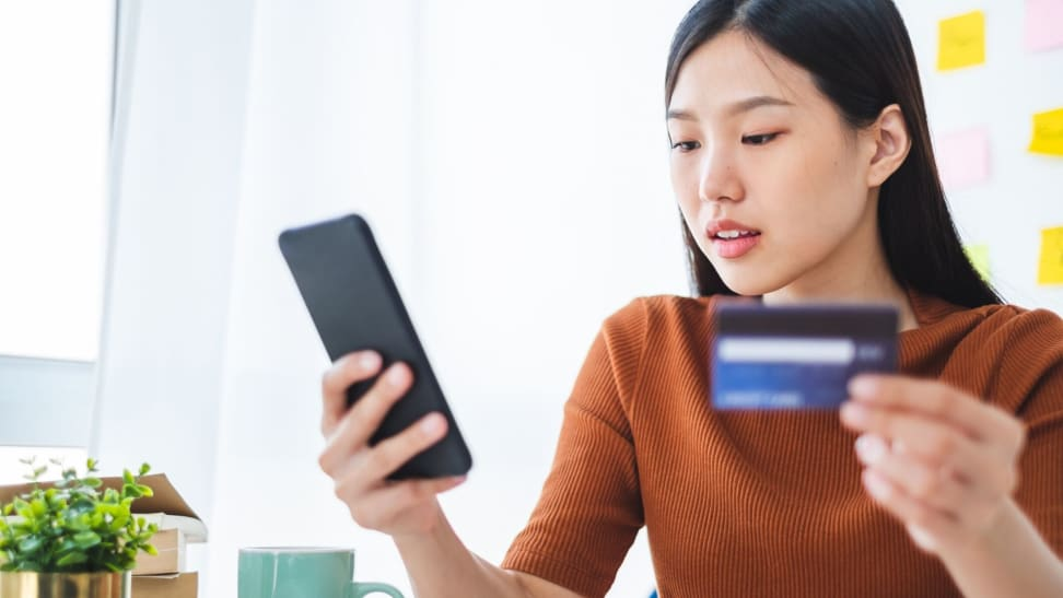 A woman paying off credit card debt