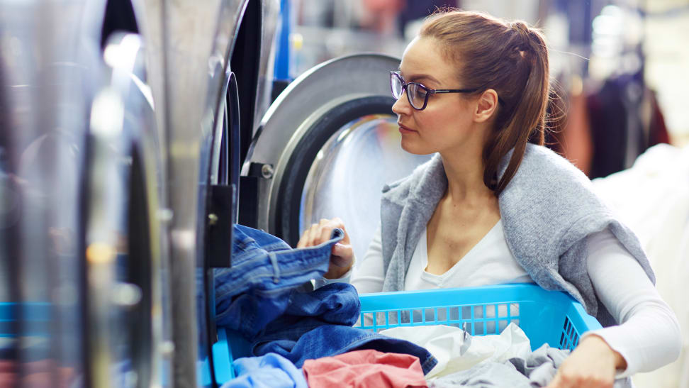 Woman doing laundry at a laundromat