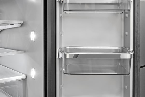 The KitchenAid KRMF706EBS's right fridge door features adjustable shelves that sit in silvery trimmed holders.