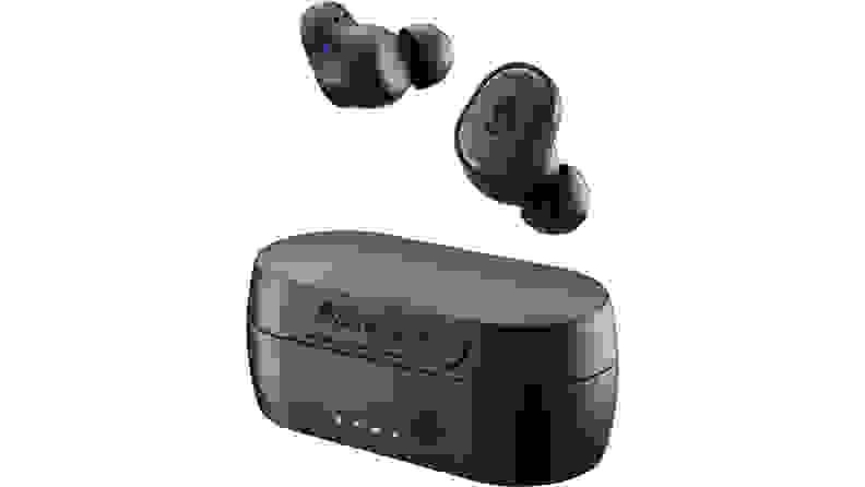 A pair of Skullcandy Sesh Evo earbuds and charging case on a white background.