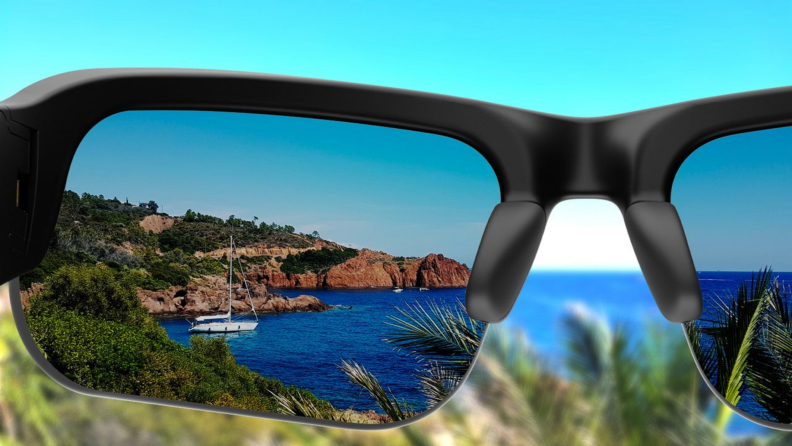 First person perspective: looking through the Bose with tinted frames at rocky shoreline cliffs.