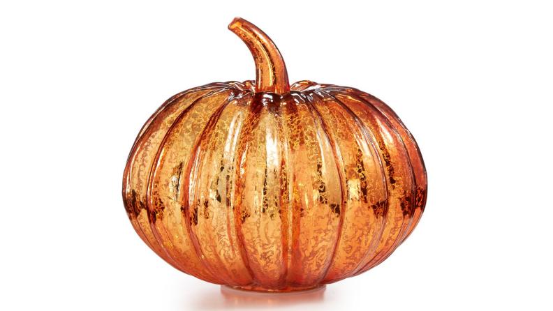 An image of an orange mercury glass pumpkin with lights inside.