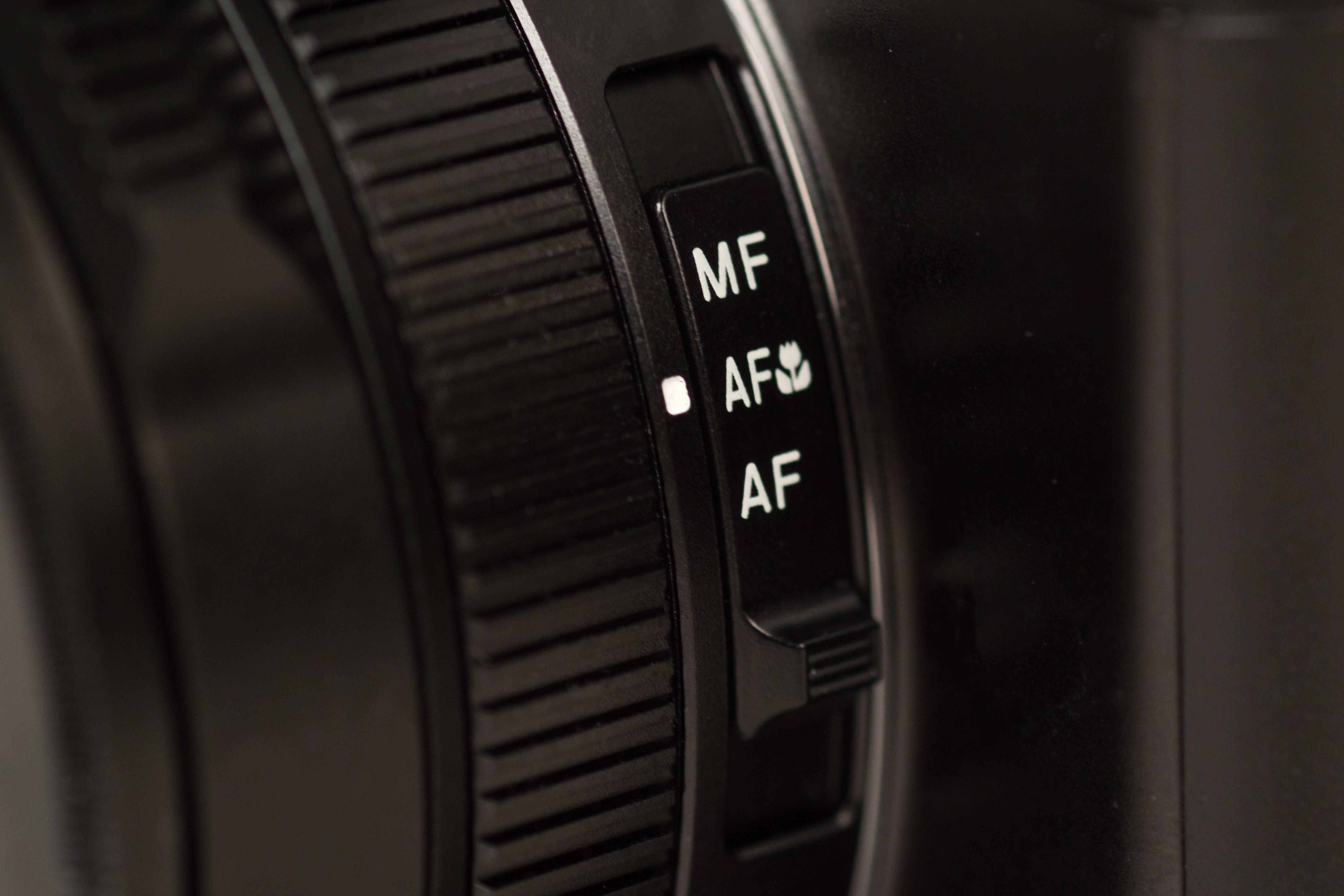 A photograph of the Panasonic Lumix LX100's focus switch.
