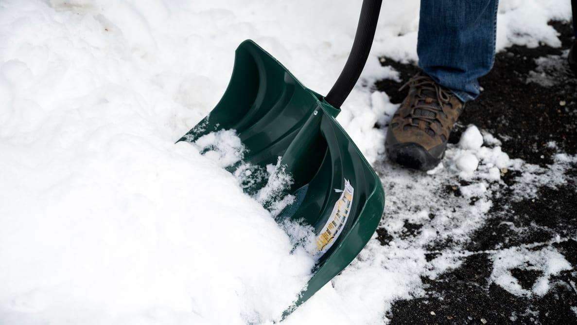 snow shovel in a snowbank
