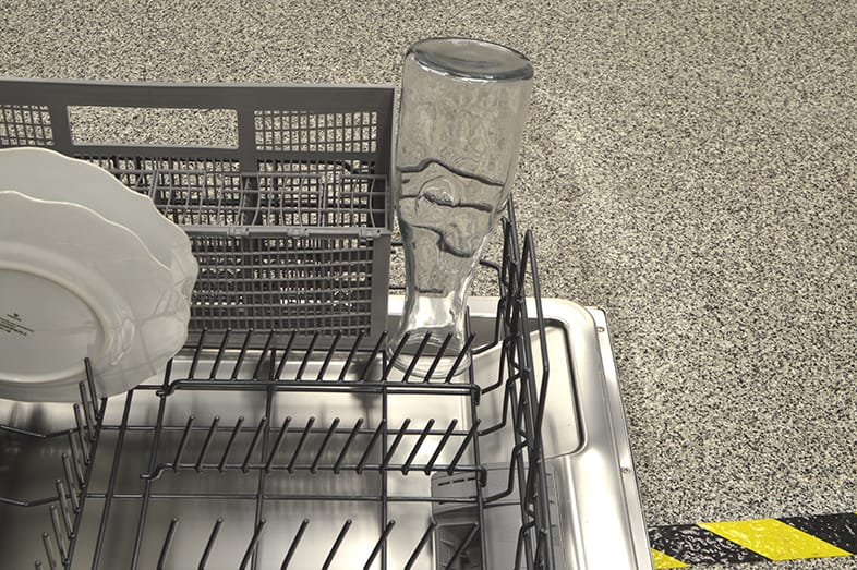 A water carafe in the dishwasher.