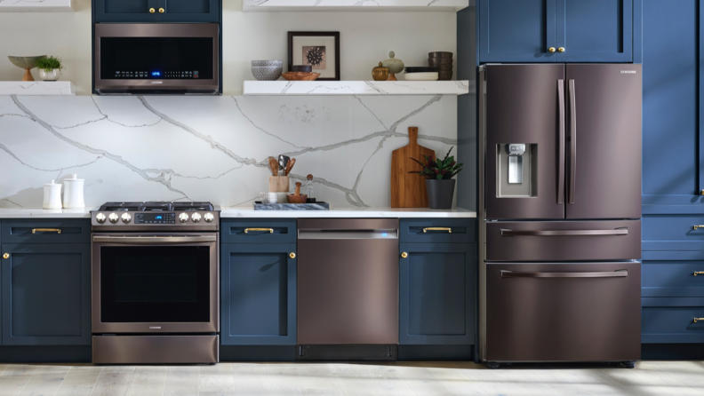 dark gray appliances in kitchen with blue walls