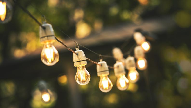 String lights hang outside.