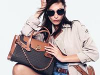 Woman holding Michael Kors bag