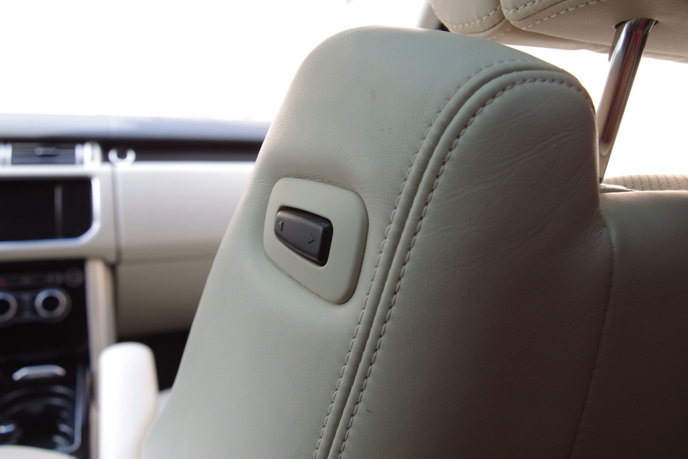 This button lets rear seat passengers move the front passenger seat forward for extra legroom.