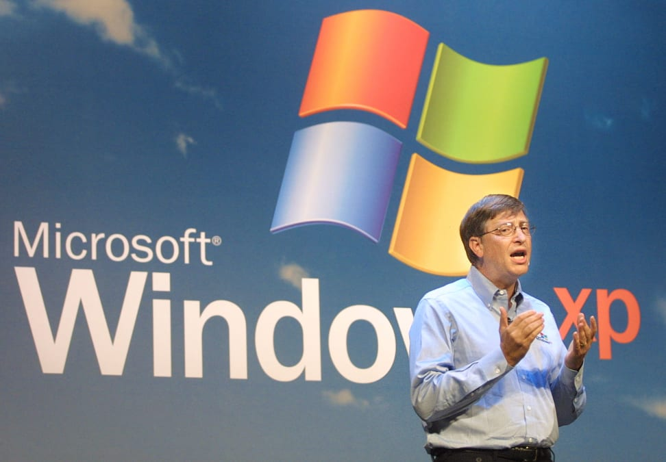 Bill gates speaks at the unveiling of Windows XP, a super old operating system you should stop using