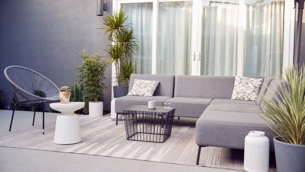Contemporary patio furniture set-up with a neutral area rug