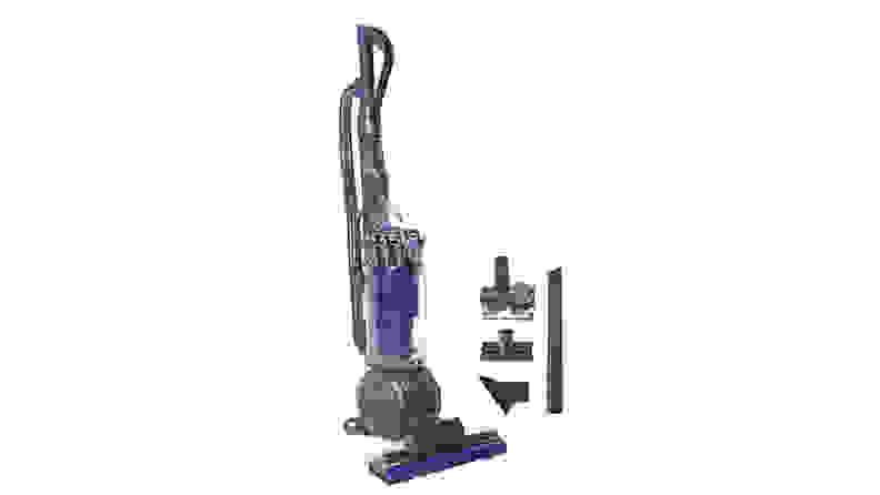 Vacuum with attachments on white background