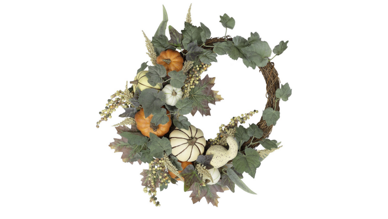 An image of an asymmetrical wreath with pumpkins, gourds, and greenery.