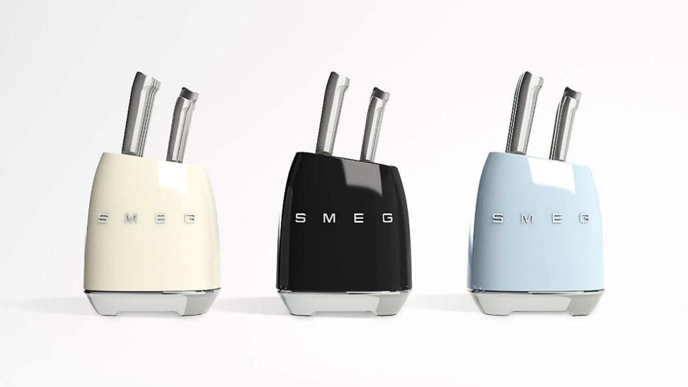 Three pastel retro-style Smeg knife block sets arranged in a row.