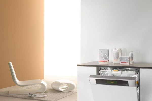 A white Futura Diamond dishwasher installed just steps away from the living room.