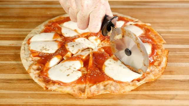 Slicing the pizza