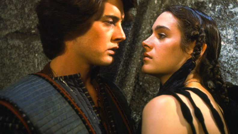 A frame from the 1984 version of Dune features Kyle MacLachlan (left) and Sean Young (right).
