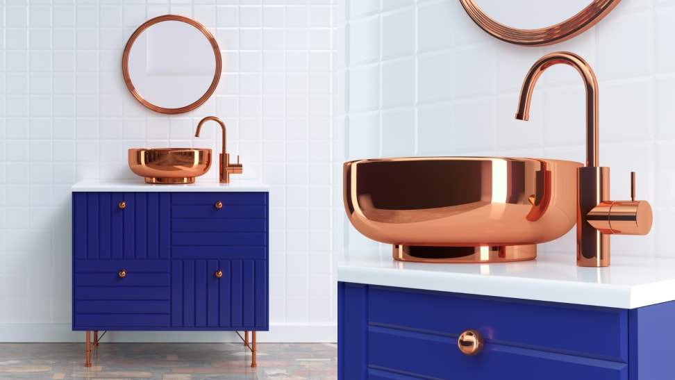 A clean minimalist bathroom with white tile, a blue cabinet and copper sink and mirror.