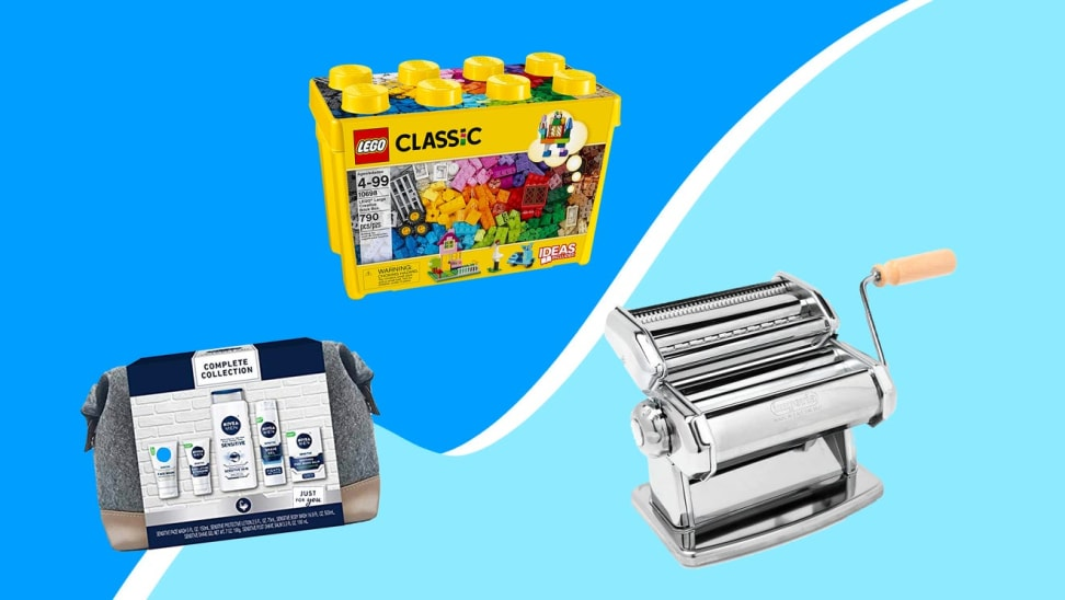 Children's toy, pasta maker, and skin care gift set in front of blue background.