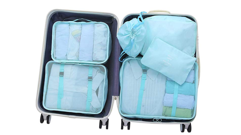 Packing cubes in a suitcase.
