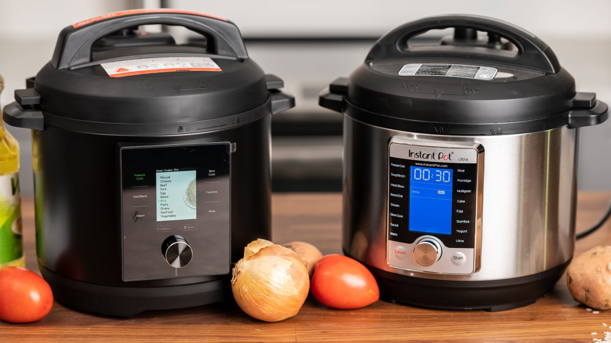 Two pressure cookers sitting side by side.