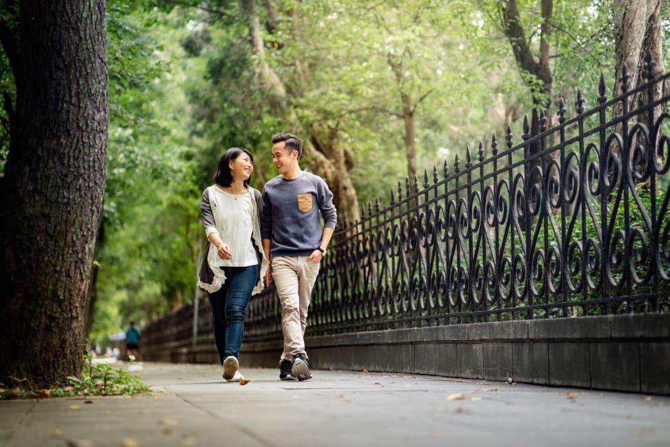 man and woman walk on pavement