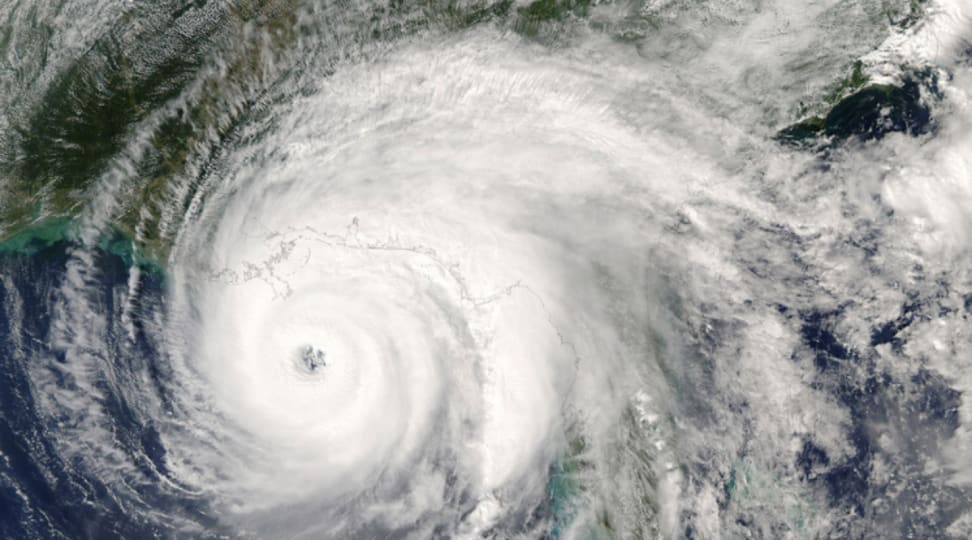 A satellite image of a hurricane swirling in the Gulf of Mexico.