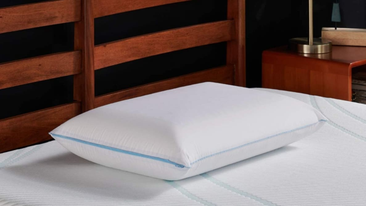 the tempur-cloud breeze pillow on a bed