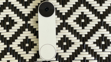 The Nest Doorbell (battery) on a black and white chair.