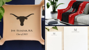 A custom leather tray with college seal next to a blanket on a chair and personalized stationery