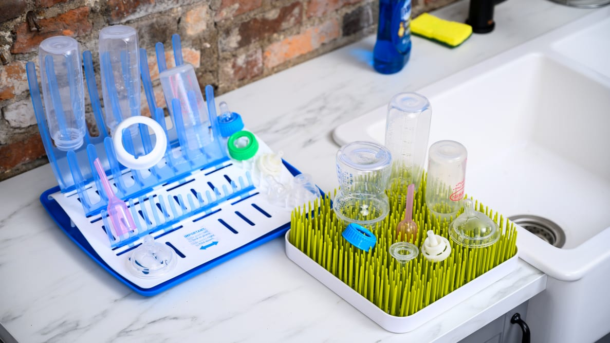 The best bottle drying racks, Boon Grass and Dr. Brown's Universal Drying Rack, holding bottles
