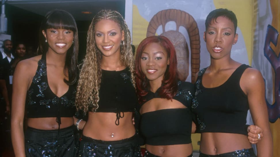 The members of the girl group Destinys Child standing next to each other smiling