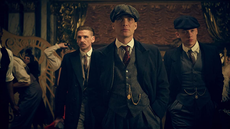 A still of the series Peaky Blinders featuring the Shelby family.